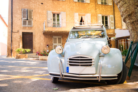 Romantic square with typical lavender blue French car photo