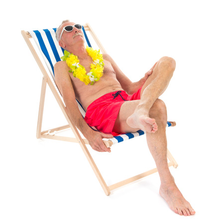 asleep chair: Retired man on vacation sitting in beach chair drinking beer Stock Photo
