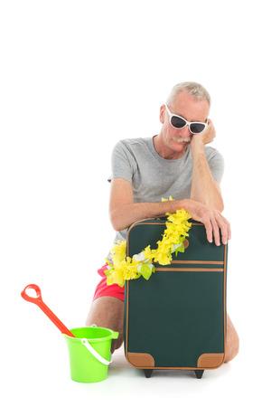 Traveler with suitcase having delay isolated over white background Standard-Bild
