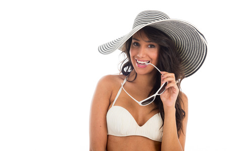 Black woman in bikini with straw summer hat and sunglasses isolated over white background Stock Photo