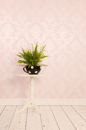 Vintage table in interior with old wall paper photo