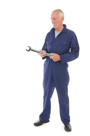Senior laborer in blue work wear with wrench isolated over white background
