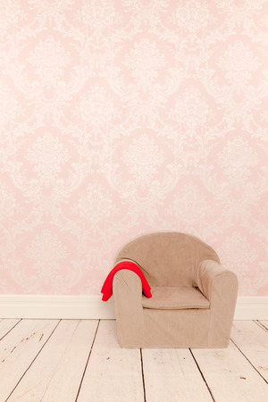 pink wall paper: Vintage chair in interior with old wall paper