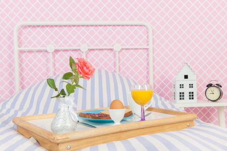 mother'sday: Breakfast with rose and bread on the bed