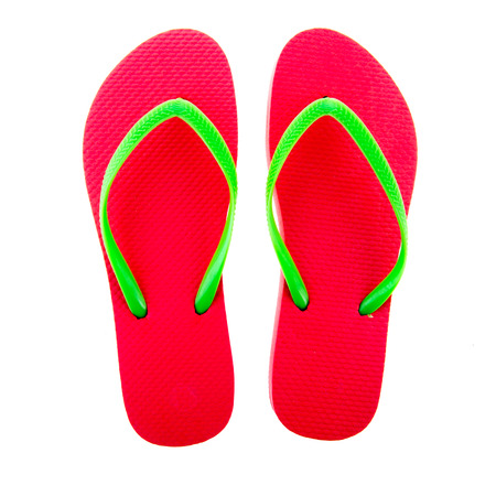 flops: Pink flip flops isolated over white background