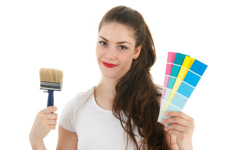 refurbish: Portrait young female adult with paint brush and color samples isolated over white background Stock Photo