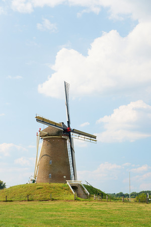 dutch typical: Typical Dutch windmill in landscape Stock Photo