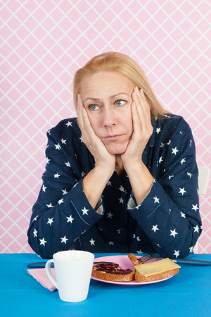 depressive: Depressive woman with breakfast in the morning Stock Photo