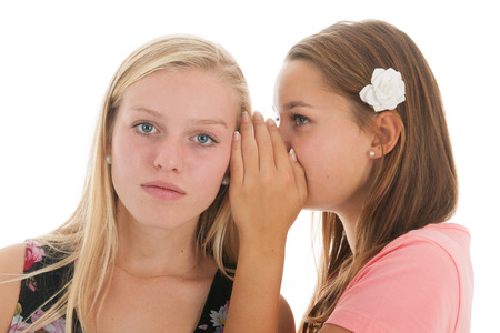 sensational: Teen girls are whispering gossip to each other Stock Photo