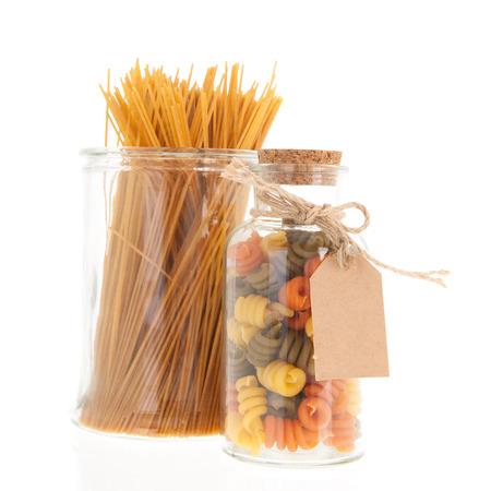 closed corks: Glass pot full with tri-colore Italian pasta and spaghetti Stock Photo