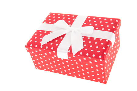 Red dotted present with ribbon and satin bow isolated over white background photo