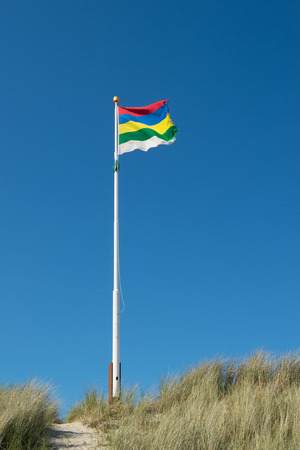 wadden: Flag in the wind on Dutch wadden island Terschelling Stock Photo