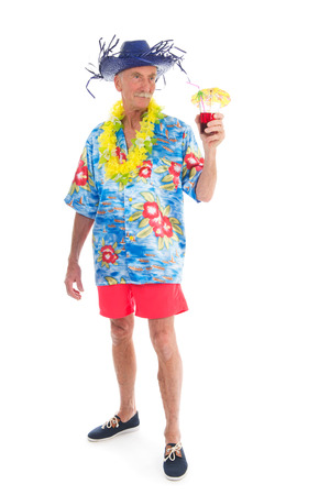 Retired man on vacation with cocktail drink isolated over white background photo