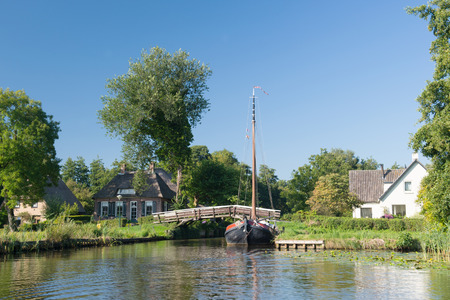 punting: Dutch village Giethoorn with water and bridges