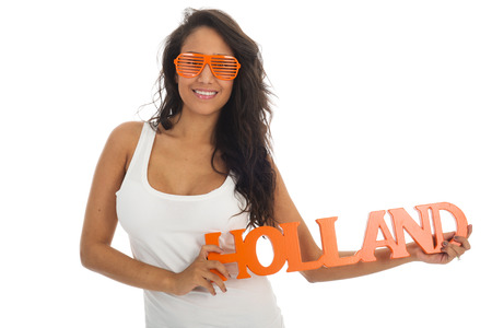 Black woman supporter for the Dutch team isolated over white background