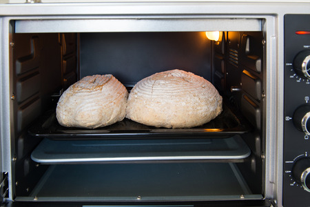 electronica: Baking rustic brown bread in oven at home