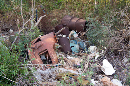 dumping: Dumping ground with metal barrels and other garbage