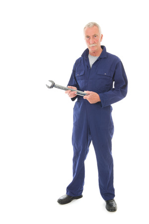 studio happy overall: Senior laborer in blue work wear with wrench isolated over white background