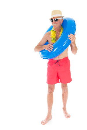 Retired man on vacation with toys isolated over white background photo