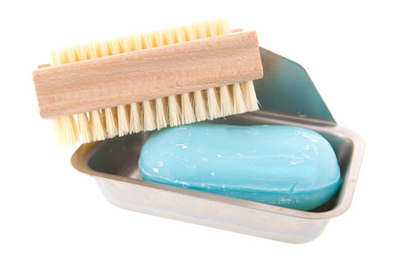 nail brush: Soap bar with nail brush in metal tray isolated over white background