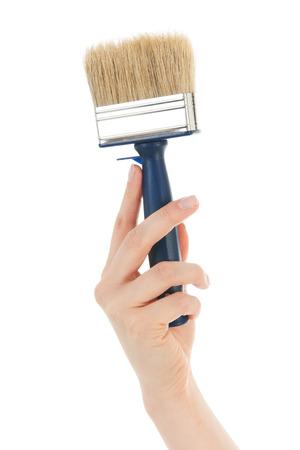 refurbish: Hand with paint brush for refurbish the house Stock Photo