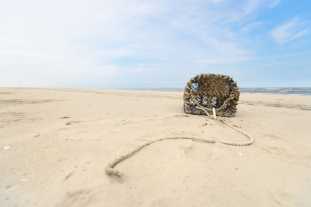 Empty lobster trap on the beach photo