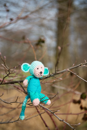selfmade: crocheted selfmade monkey toy sitting in tree
