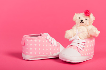 hand made: White hand made teddy bears and pink baby shoes