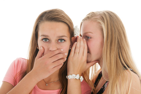 outrageous: Teen girls are whispering gossip to each other Stock Photo