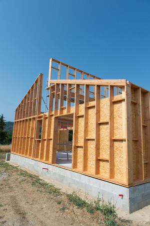 front of house: Frame of building a wooden house
