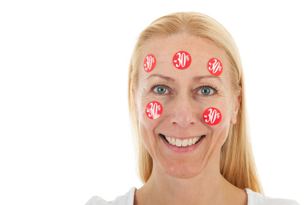 reduced: Middle aged woman happy with reduced prices