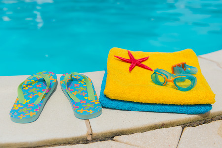 swim shoes: Summer vacation at the swimming pool Stock Photo