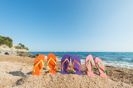 flip flops: row colorful flip flops at the beach Stock Photo