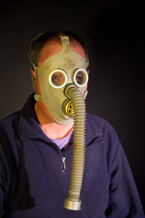 man with mask in the dark photo