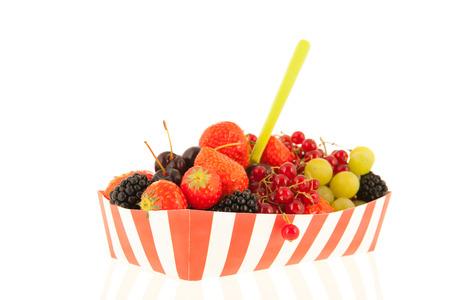 snack box full with fresh summer fruit isolated over white background photo