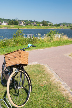 meuse: River the Meuse in landscape with Dutch bike in front