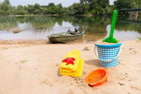 river side: Toys in the sand at the river side
