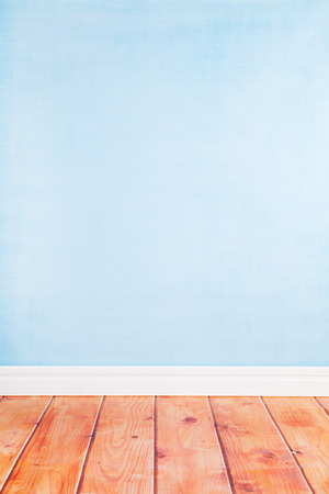 living room: Empty living room with blue wall paper and wooden floor Stock Photo