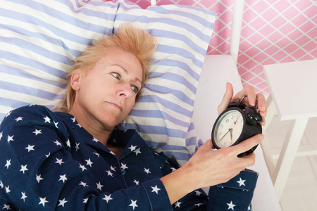 bedstead: Blond woman of mature age with insomnia