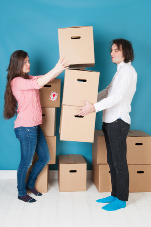 furnish: Young couple moving into a new house