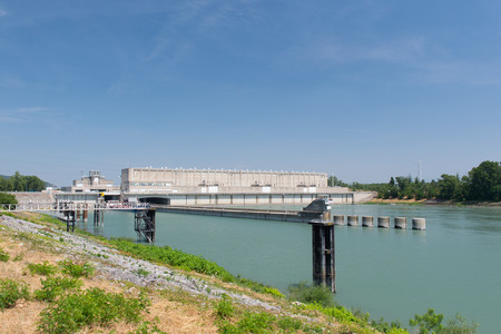 sluice: River the Rhone with weir and sluice
