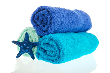 white towels: Blue rolled towels with starfish isolated over white background