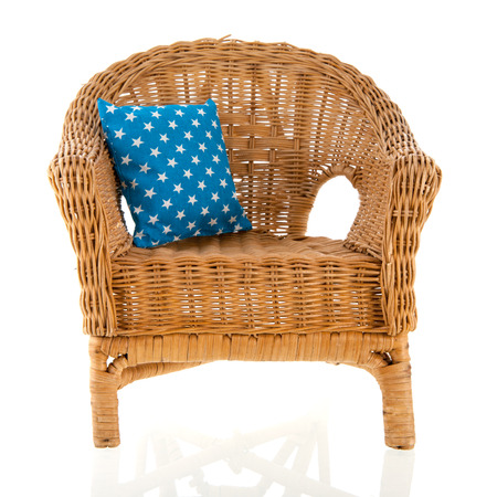 white pillow: Wicker chair with colorful pillows
