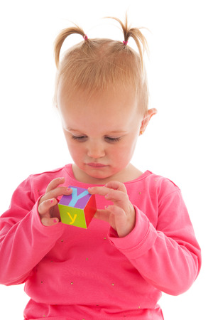 building backgrounds: Portrait toddler girl playing with blocks isolated over white background