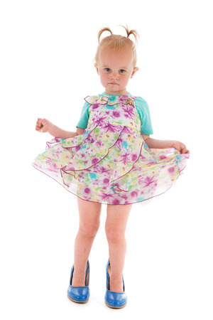 big shoes: Toddler girl standing inmothers big shoes isolated over white background
