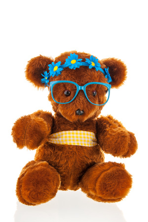 funny glasses: Funny stuffed bear with blue hair dress and glasses isolated over white background