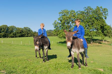 farm boys: Farm boys riding on their donkeys