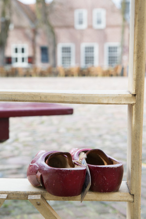 clogs: Typical red Dutch clogs for sale Stock Photo