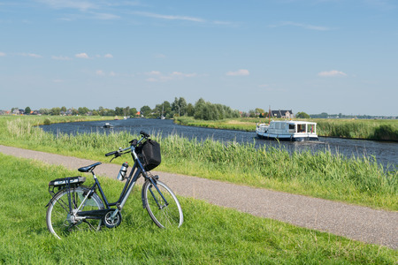 eempolder: Typical Dutch landscape with river water and bike Stock Photo