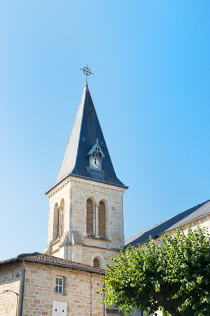 le: Tower of church in French Peyrat le Chateau Stock Photo